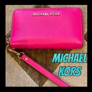 Hot pink Michael Kors smartphone wristlet